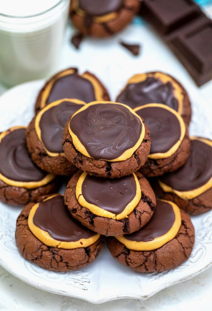 Buckeye Brownie Cookies are decadent pieces of brownie-like cookies, topped with peanut butter and chocolate! #cookies #christmascookies #christmasrecipes #sweetandsavorymeals #chocolate