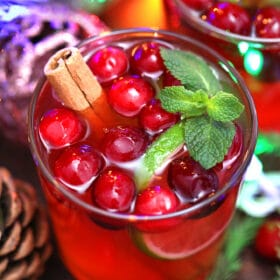 Christmas Punch is a festive, and refreshing drink that is made with pomegranate, lime, and cranberries, and ready in 5 minutes. #christmaspunch #punchrecipe #christmas #christmasrecipes #sweetandsavorymeals