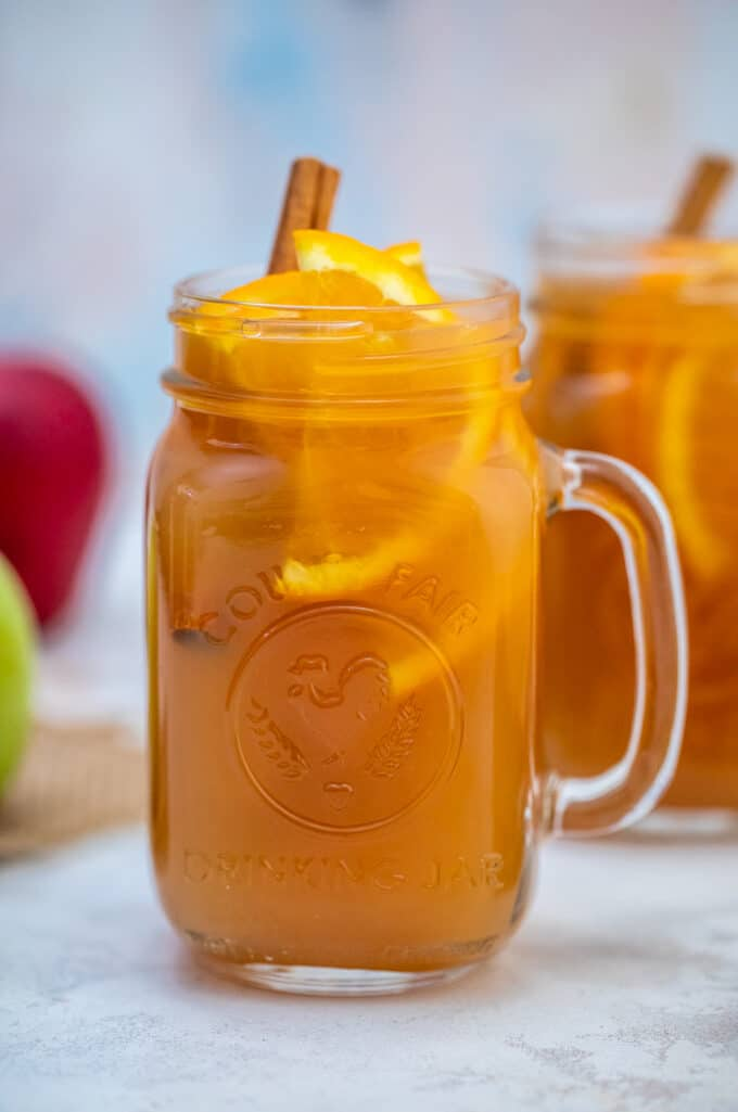 Homemade Apple Cider Recipe is made with apples, oranges, spices, water, and maple syrup. #cider #applecider #drinks #sweetandsavorymeals #fallrecipes