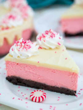Peppermint Cheesecake is the most festive dessert this Christmas! It is not your ordinary dessert. It is rich, decadent, and refreshingly unique! #cheesecake #peppermint #christmasrecipes #christmasdesserts #sweetandsavorymeals