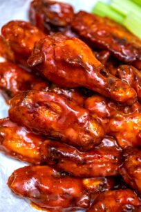 Baked Buffalo Wings are super crispy and coated in a delicious homemade spicy sauce. They are the perfect snack or party food! #buffalo #chickenwings #buffalosauce #partyfood #fingerfood #sweetandsavorymeals