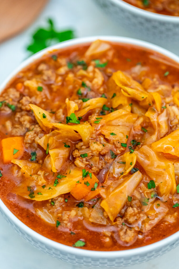 Cabbage Roll Soup is hearty and has all the flavors of a cabbage roll. #soup #cabbagerollsoup #cabbageroll #souprecipes #sweetandsavorymeals