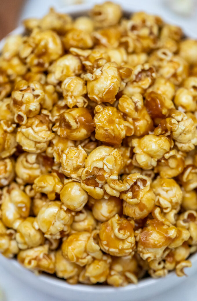 Caramel Popcorn is sweet with just the right balance of crunch and chewiness! Prepare a huge batch of this favorite snack for your next movie night! #caramel #popcorn #caramelpopcorn #snacks #sweetandsavorymeals