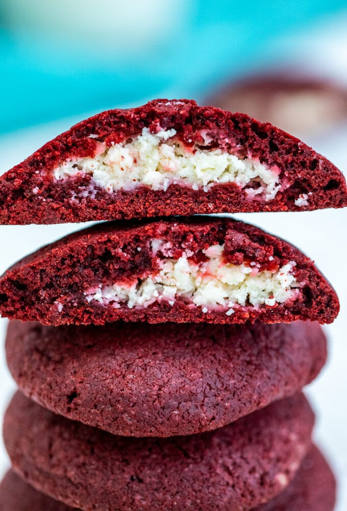Cheesecake Stuffed Red Velvet Cookies are creamy, festive, and are the perfect treat to have during the holiday season. #cookies #redvelvet #christmasrecipes #valentinesday #sweetandsavorymeals