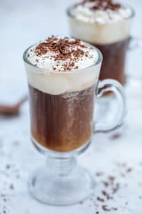 Irish Coffee Recipe is made with freshly brewed coffee, sugar, whiskey, and whipped cream. #irishcoffee #irishrecipes #irishfood #stpatricksday #sweetandsavorymeals #drinks