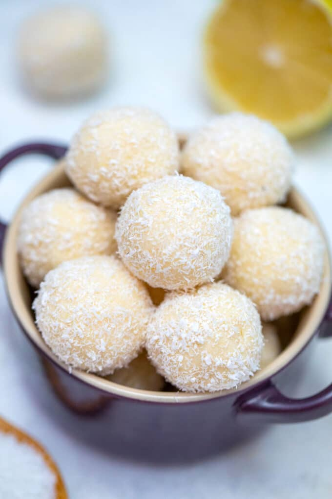 Keto Lemon Coconut Cheesecake Fat Bombs are a keto dieter's best friend! They are extremely decadent and rich just like any dessert but without sugar! #keto #ketorecipes #ketodesserts #sweetandsavorymeals #fatbombs