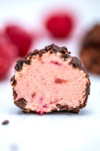 Keto Strawberry Cheesecake Fat Bombs can make you forget that you are avoiding carbs! Satisfy your cravings with this easy, low-carb and tasty treat! #ketorecipes #ketofatbombs #ketodesserts #sweetandsavorymeals #lowcarbdesserts