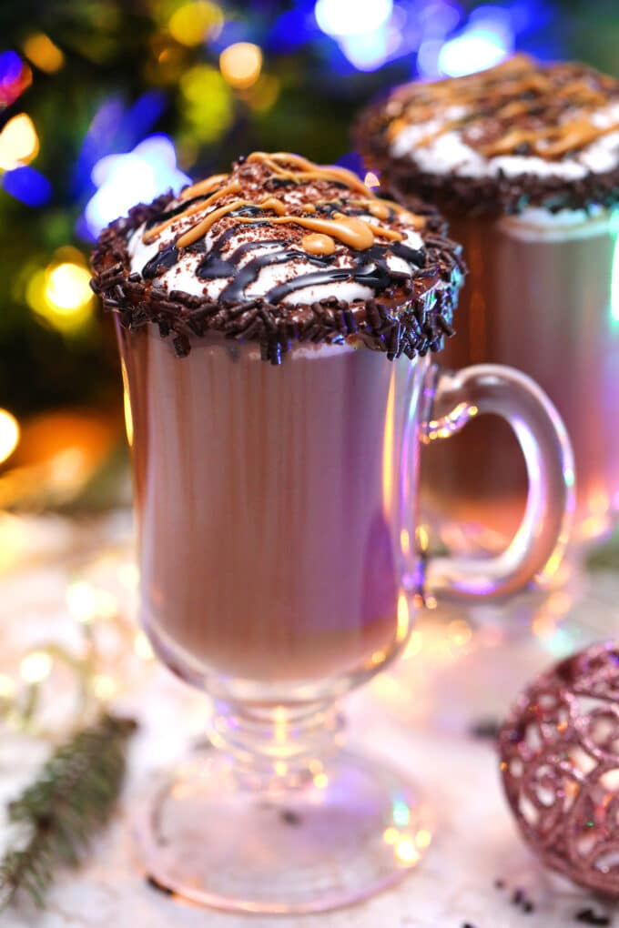 Peanut Butter Hot Chocolate is sweet, luxuriously creamy, nutty, and rich! Make this your coffee substitute this cold holiday season! #peanutbutter #chocolaterecipes #hotchocolate #beverages #hotdrinks #sweetandsavorymeals