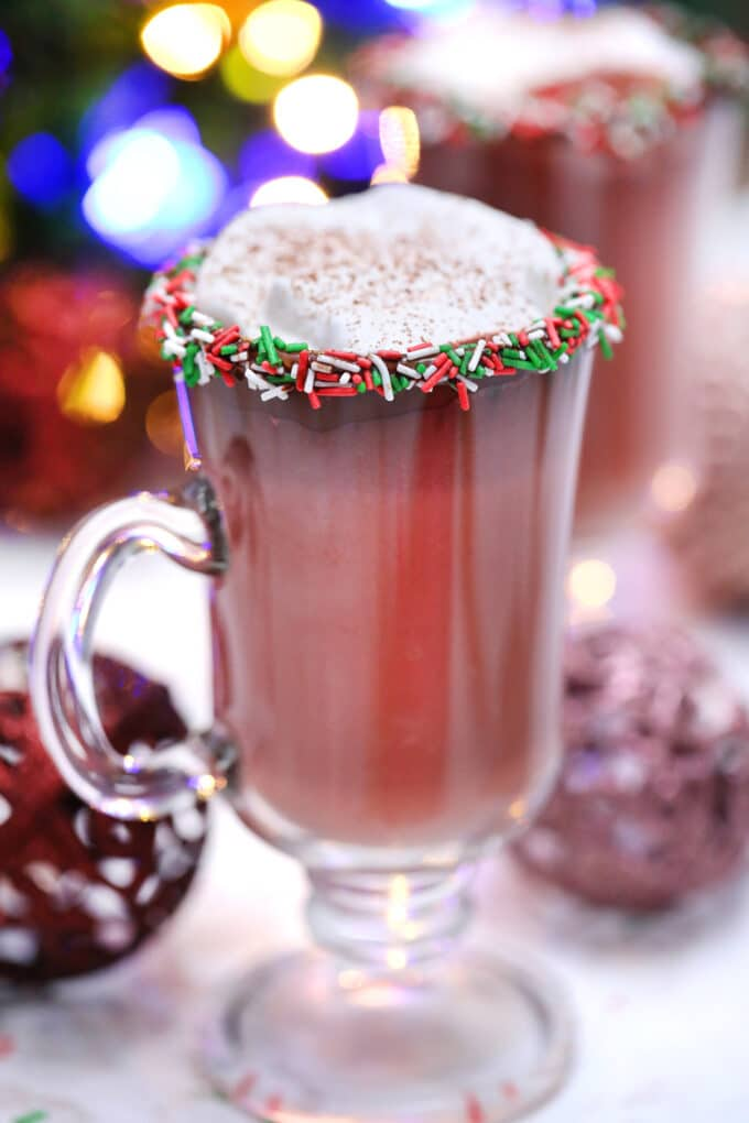 Red Velvet Hot Chocolate is luxurious and rich, topped with a dollop of whipped cream, and the perfect holiday treat. #hotchocolate #redvelvet #christmasrecipes #valentinesdayrecipes #sweetandsavorymeals