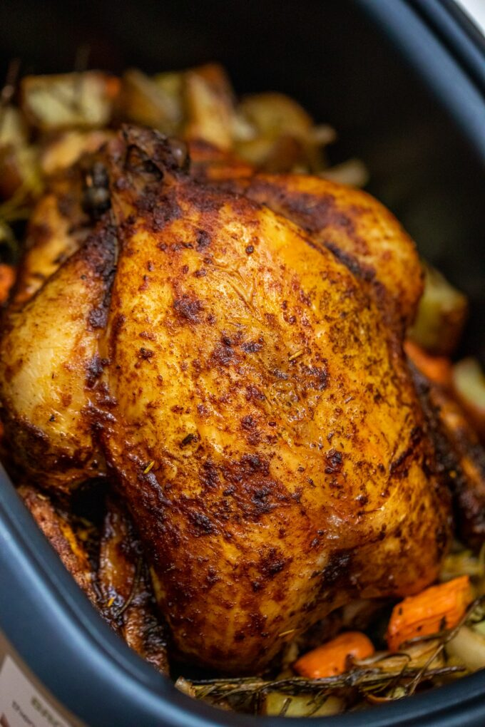 Image of crockpot whole chicken with vegetables.