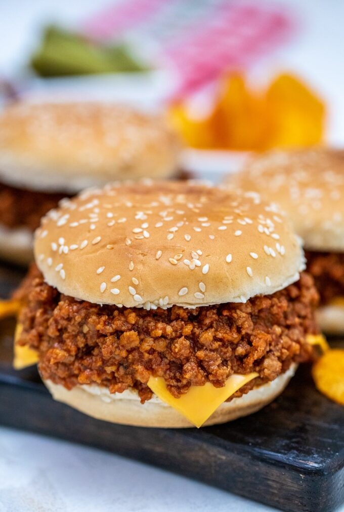 Crockpot sloppy joes with cheese on a wooden board