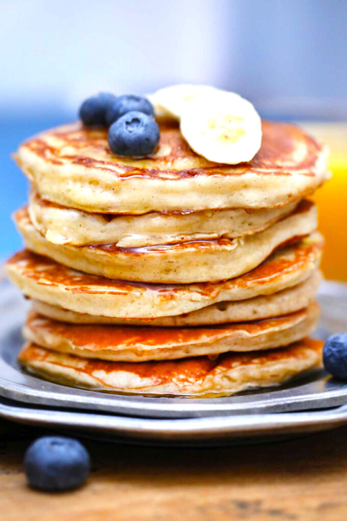 photo of greek yogurt pancakes with blueberries and bananas