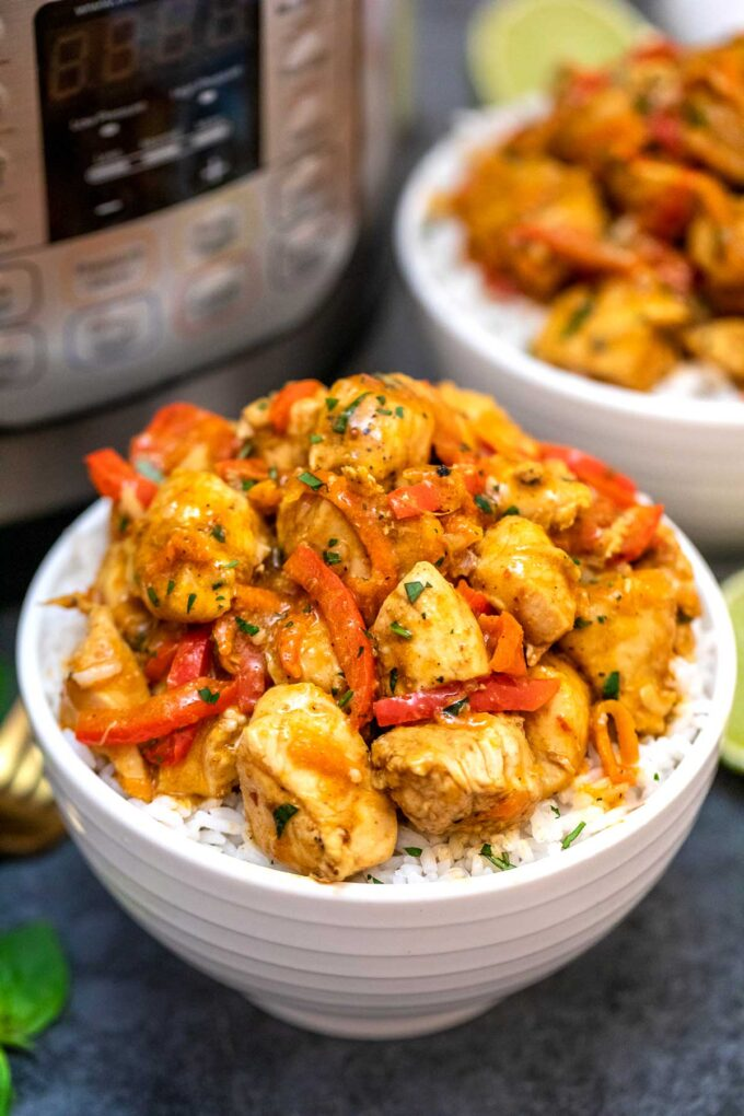 image of instant pot coconut curry chicken in white bowls