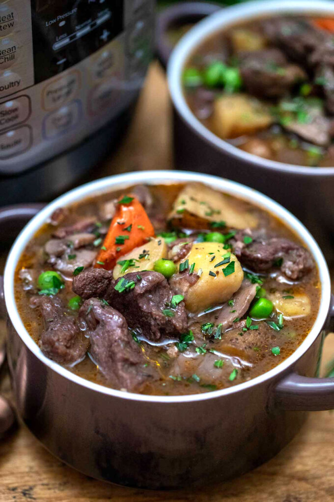 photo of instant pot lamb stew in serving bowls