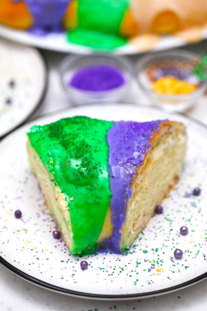 image of king cake slice with purple and green glaze