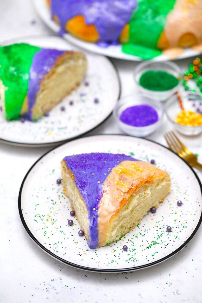 image of king cake slice with golden and purple glaze