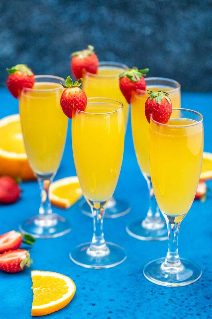image of flutes of mimosas garnished with fresh strawberries