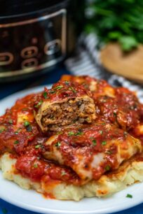 photo of slow cooker stuffed cabbage rolls with mashed potatoes