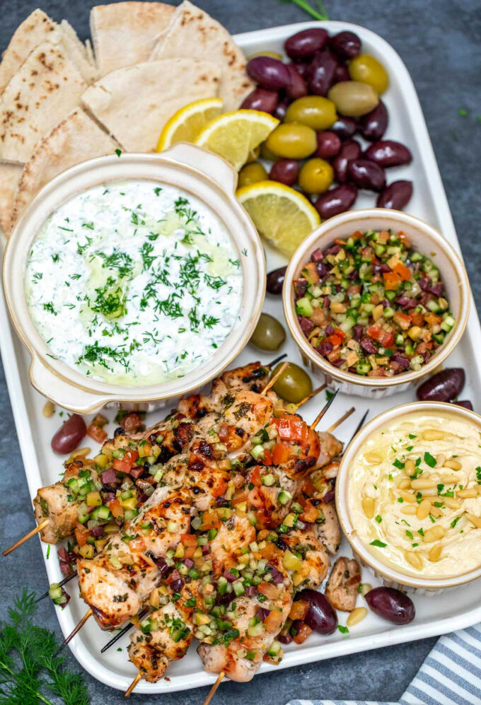photo of chicken souvlaki platter with creamy yogurt dip, olive relish and hummus