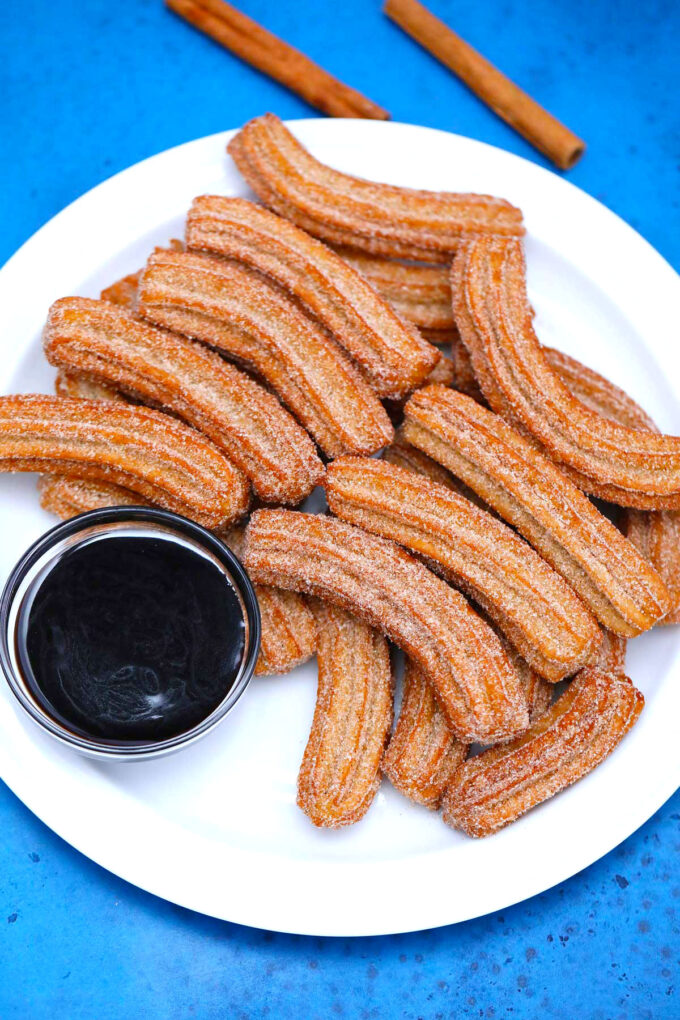 photo of fresh churros and chocolate sauce