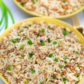 image of dirty rice served with green onions
