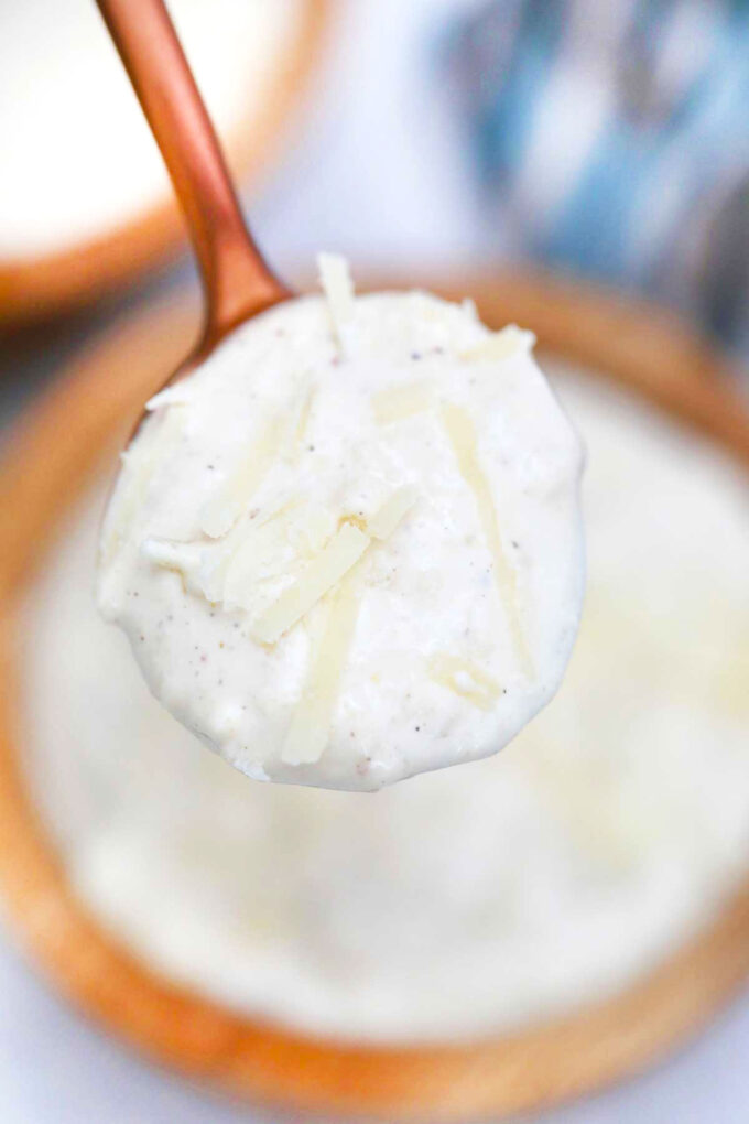 photo of a spoonful of caesar dressing