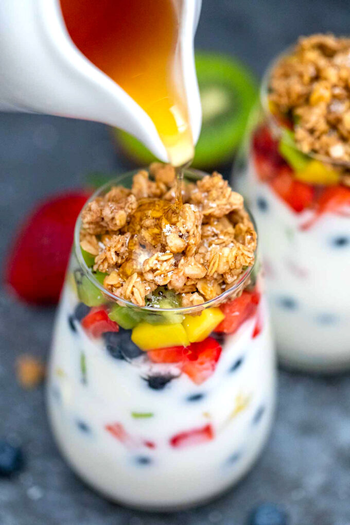 image of yogurt parfaits with granola and honey