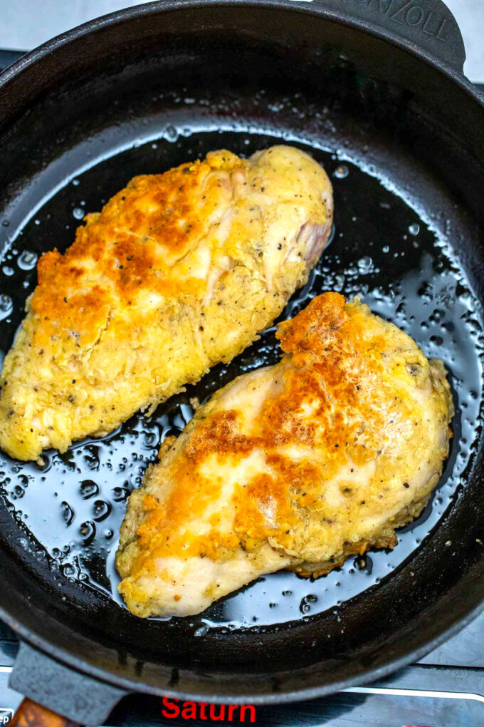 Photo of frying chicken breasts.