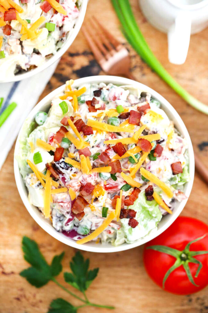 Image of overnight salad with bacon and cheese.
