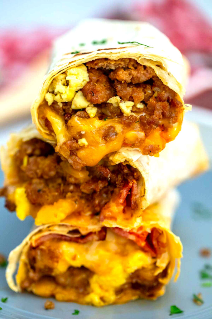 Image of sausage egg and cheese breakfast burrito in flour tortilla.