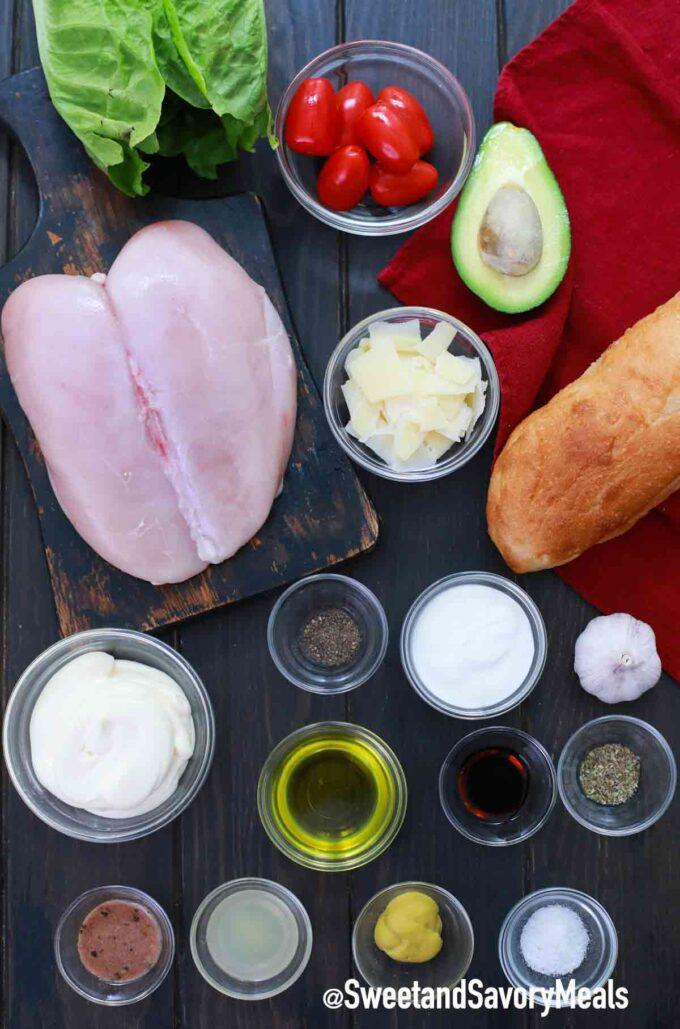 avocado chicken Caesar salad ingredients on a wooden table
