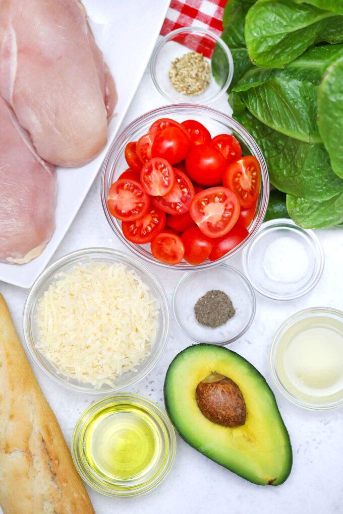 Image of avocado chicken caesar salad ingredients.