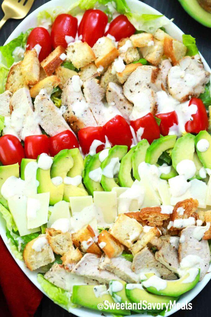 avocado chicken Caesar salad on a serving plate