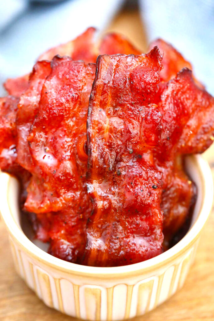 Image of homemade candied bacon in a white bowl.