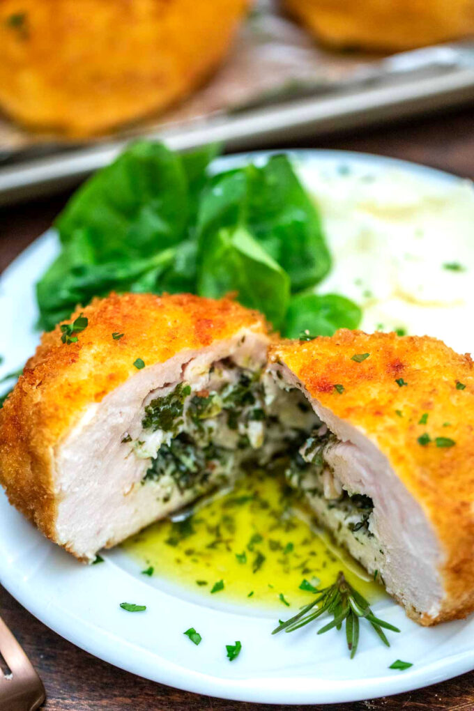 Picture of chicken Kiev with mashed potatoes.