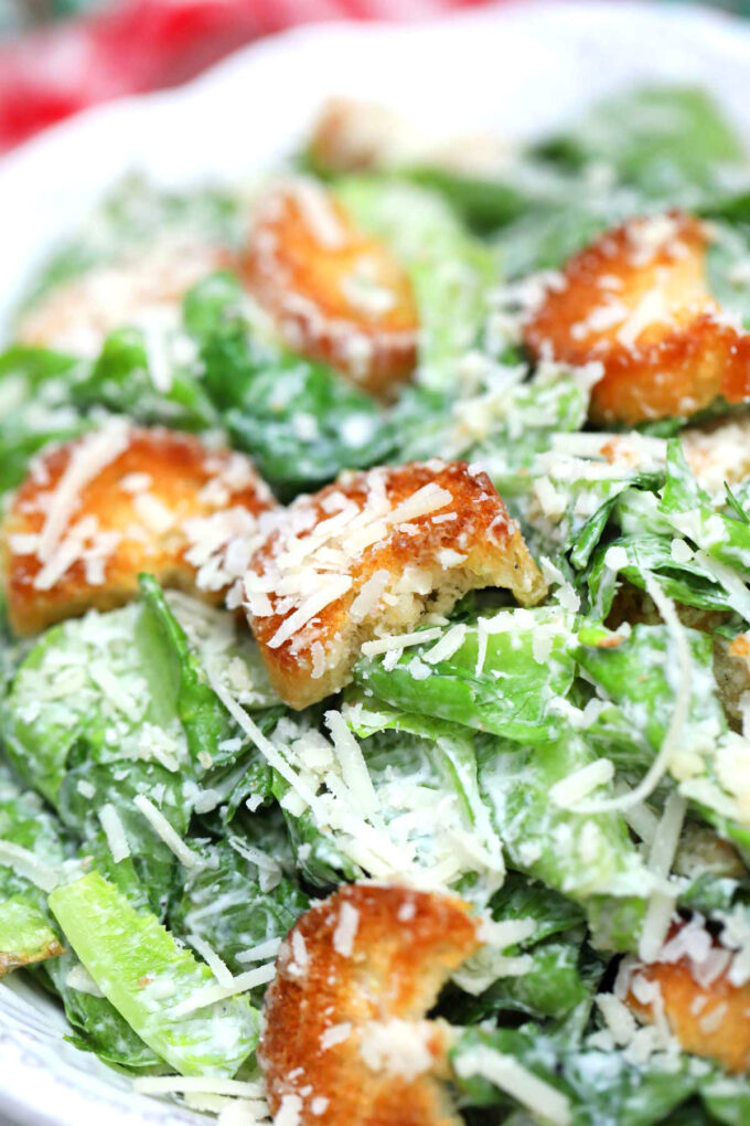 Image of Caesar salad with croutons and parmesan.