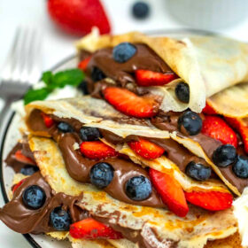 Photo of homemade crepes filled with Nutella.