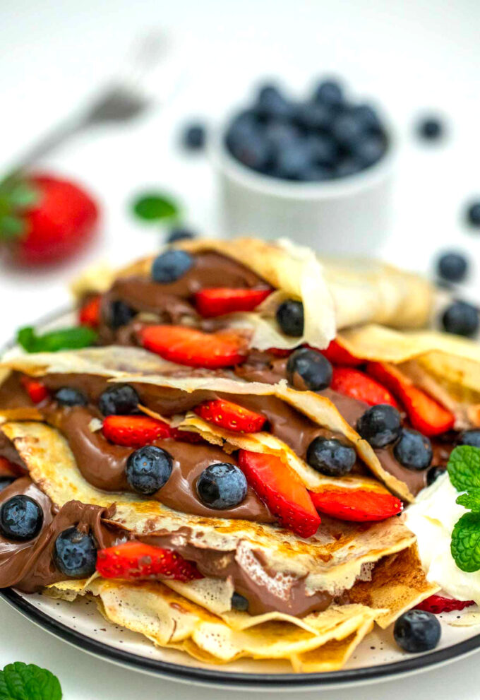 Image of French crepes stuffed with Nutella and berries.
