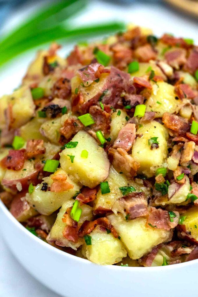 Photo of German potato salad in a white bowl