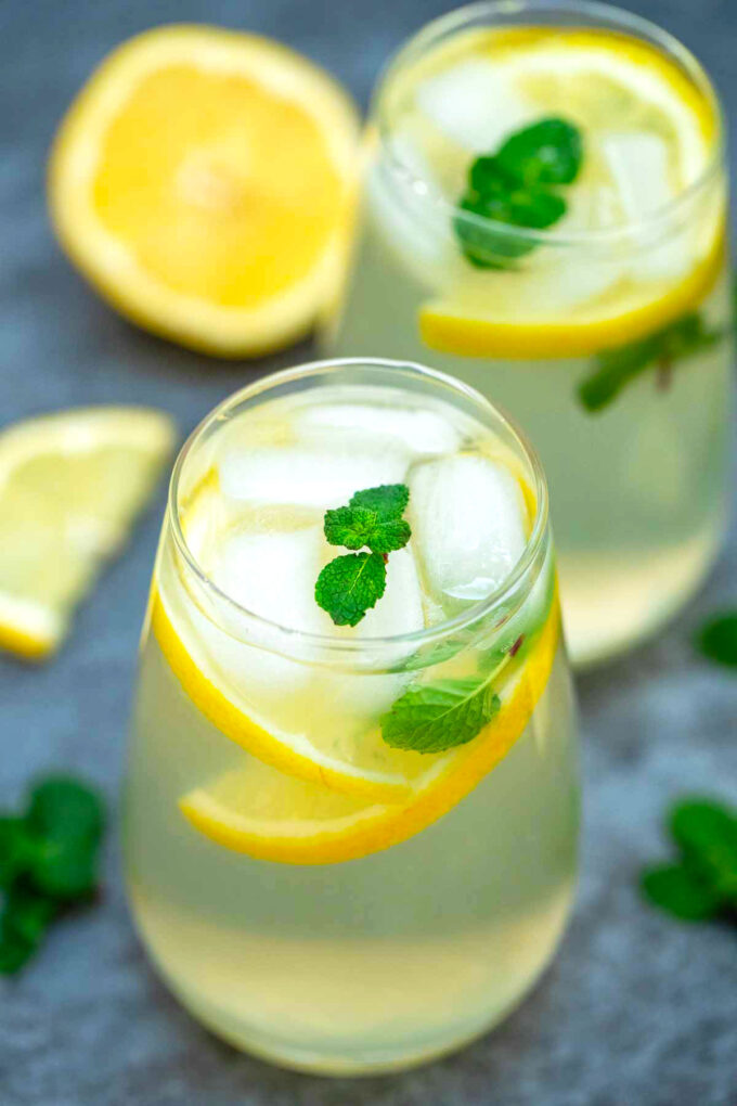 Photo of homemade lemonade with lemon slices and mint.