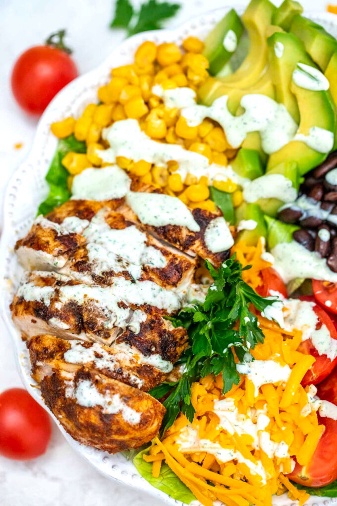 Photo of southwest salad with chicken corn avocado and cheese.