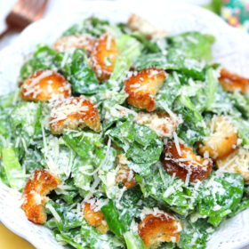 Image of homemade Caesar salad in a white bowl.