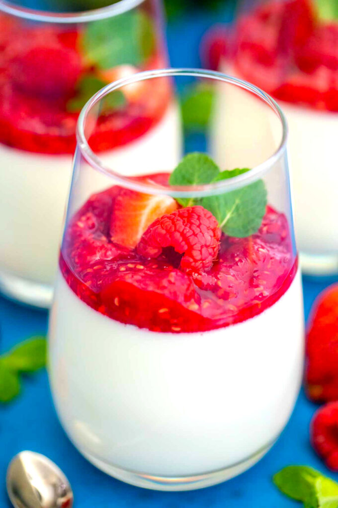 Photo of homemade Panna Cotta with raspberry and mint.