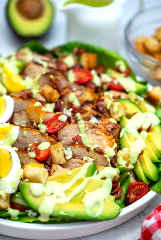 Picture of Cobb salad with eggs chicken and homemade dressing.