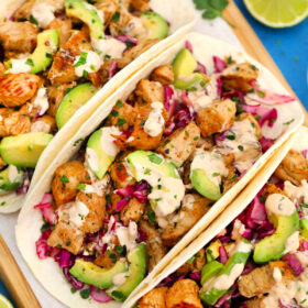 Photo of chipotle chicken tacos with chipotle cream.