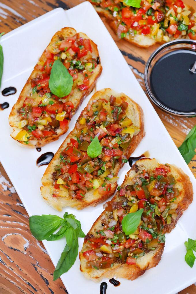 Photo of tomato bruschetta with basil.