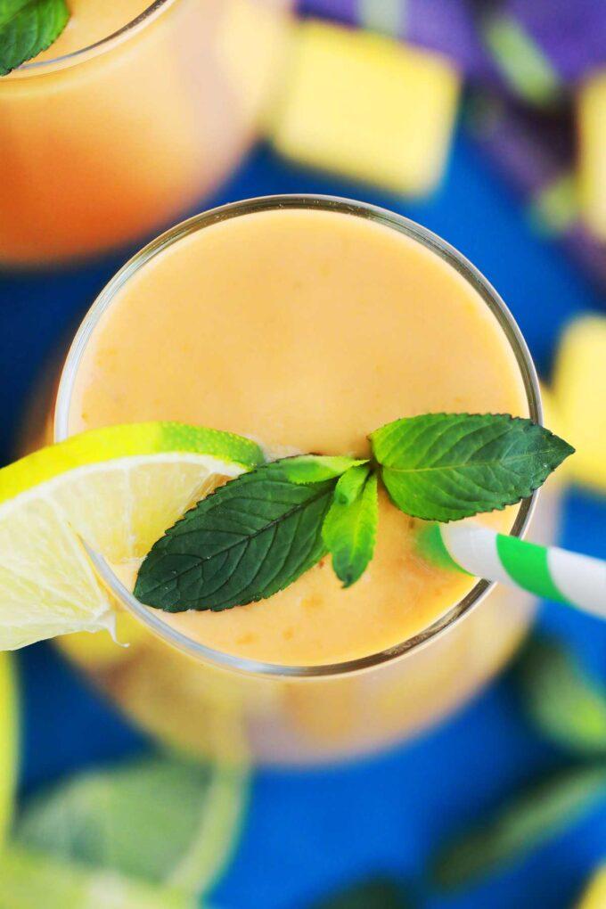 Image of mango smoothie with fresh mint.