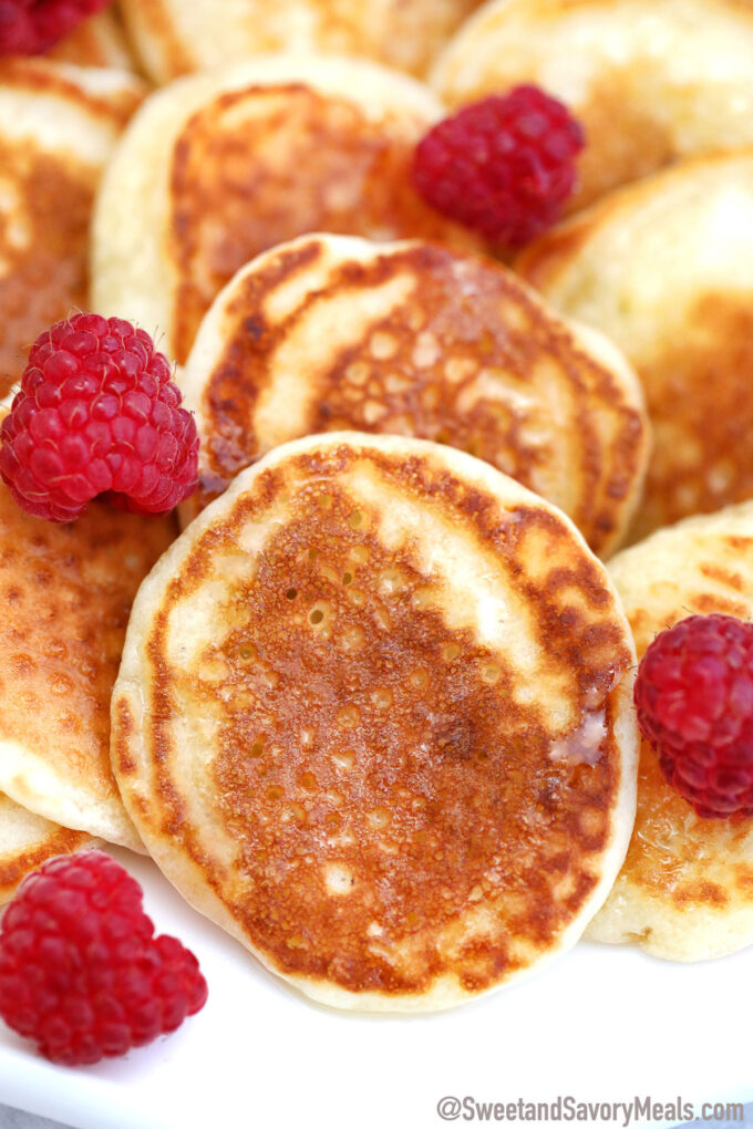 Image of silver dollar pancakes with raspberries.