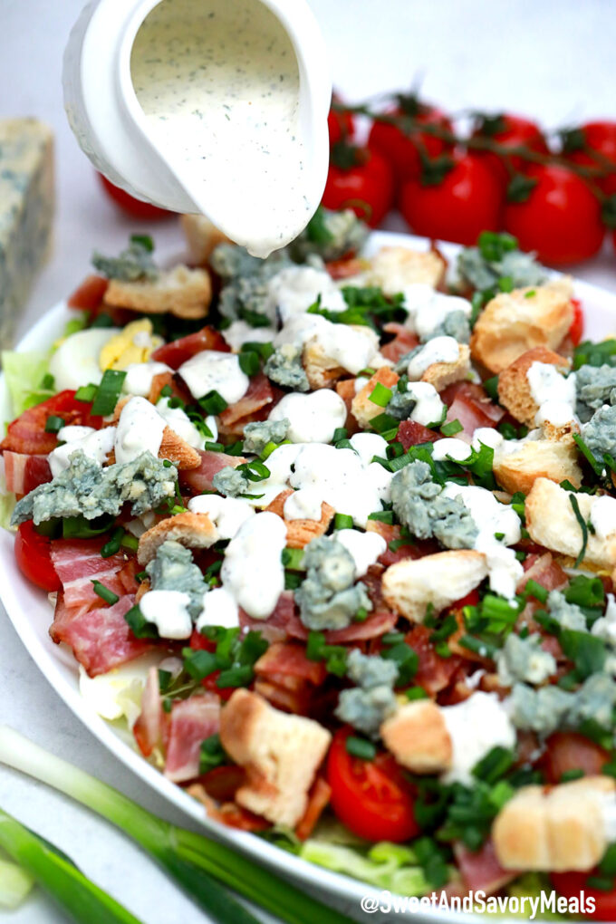 Picture of BLT salad with blue cheese dressing.