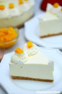 Photo of a slice of no bake mango cheesecake.